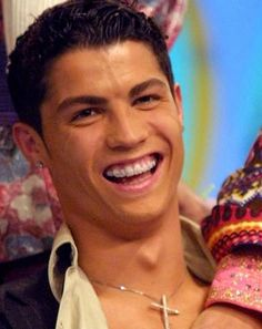 Before he was playing in the FIFA World Cup, Cristiano Ronaldo sported braces! Celebrities With Braces, Guys With Braces, Braces Girls, Cristiano Ronaldo Young, Cristiano Ronaldo Cr7, Dental Photography, Portugal National Team, Celebrity Smiles, Brace Face