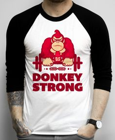 Donkey Strong Donkey is done with the Kong and onto the strong. He's busting out some sweat at the gym so he'll be able to get the princess from Mario. What are you doing?! Stop gaming, and get yourself to the gym! Use Donkey Kong as a source of inspiration and rock this geek fitness shirt at the same time! top, tank top, racerback, funny, retro, vintage, clothes, graphic, swag, dress, hipster, fitness, yoga, crossfit, lift, beast, diet, sale, body transformation