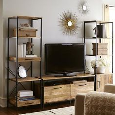 """Named for the Hindi word meaning """"strength,"""" our Takat TV Stand makes a strong statement indeed. Built on a sturdy iron frame and made of bold-grained mango wood, it has an open shelf and two drop-door storage compartments for versatile media storage. Exotic-looking, yet completely functional, it's crafted in India, at home anywhere."""
