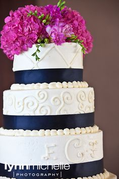 modern pink wedding, black and white 3 tier wedding cake with pink floral accents.