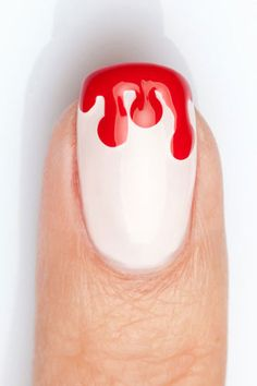 This bloody nail design is a subtle way to show your Halloween spirit this season! Get the details here.