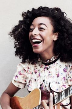 corinne bailey rae curls hair natural music musician artist happy smiles laughing