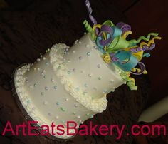 Two tier anniversary buttter cream cake with sugar ribbons photo Colorfulribbonsandpearlstwotierbutt.jpg