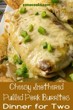 These amazing Cheesy Smothered Pulled Pork Burritos are stuffed with a slow cooked smoky pulled pork, diced green chiles, and rice mixture covered in green enchilada sauce and smothered with gooey melted Monterey Jack cheese. Pork Burritos, Smothered Burritos, Mexican Dishes, Mexican Food Recipes, Pulled Pork Enchiladas, Pork Recipes, Cooking Recipes, Green Enchilada Sauce, Meals For Two