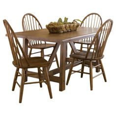 $533.95 hanson dining set Gather friends and family for home-cooked meals around this classic dining set, showcasing a trestle-inspired table and 5 handsome Windsor chairs.
