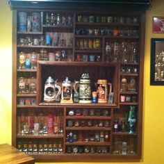 OMG... This Shot glass display would be perfect for all my souvenir glasses