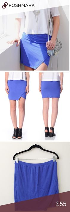 """Abbeline Blue Solid Asymmetrical Skirt NWT from South Moon Under. A classic mini skirt from Abbeline with a little twist. Asymmetric front, elastic enforced waistband. Blue color, perfect for fall! 47% rayon/47% polyester/6% spandex. Size L. Length 16.5"""", waist 14"""". No modeling/trades. Abbeline Skirts Asymmetrical"""