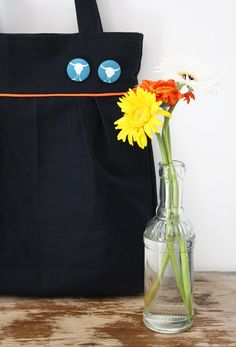 Navy blue pleated tote bag with tangerine piping!