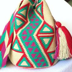 These double thread Wayuu mochila bags are all made in the region of La Guajira, Colombia by indigenous Wayuu women. Mochila bags are a very important handicraft that helps sustain the indigenous Wayuu people. These bags take approximately 10 days to make. The craft of crocheting is learnt at an early age and passed down from generation to generation. The mochilas are a reflection of the everyday shapes that surround the lives of the Wayuu tribe. Buy yours atwww.lombiaandco.com Tapestry Crochet, Tabata, 10 Days, Handicraft, Vivid Colors, Crocheting, Reflection, Age, Shapes