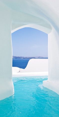 Take in views of endless blue in an outdoor hot tub in Santorini