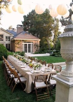 paper lanterns, bamboo chairs, long table.