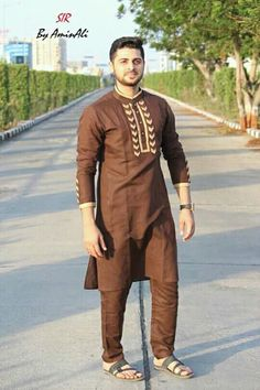Mens Designer festive cotton pathani suit with collar neck, short button placket and full sleeves and curve hem. Comes with matching bottom. Punjabi Kurta Pajama Men, Kurta Men, Latest Kurta Designs, Mens Kurta Designs, African Shirts For Men, African Dresses Men, Designer Suits For Men, Designer Clothes For Men, Indian Men Fashion