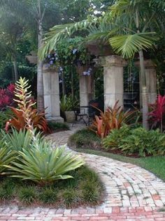 Old stones used as columns for rustic pergola in a msouth florida backyard. tropical landscape