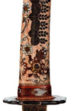 Japanese sword pommel decorated in polychrome cloisonné with foliage inhabited by Kara-shishi against a light brown enamel ground, from Edo period (1586~1911)