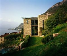 Italian Stone House with rustic appeal on Lake Como, by architect Arturo Montanelli