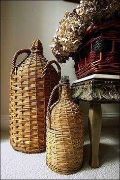 A pair of wicker encased antique bottles