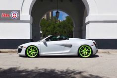 Audi R8 Spyder. White with lime green kicks.