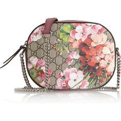 Gucci Blooms Gg Supreme Leather-Trimmed Printed Coated Canvas Shoulder Bag as seen on Dakota Johnson