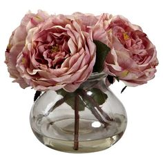 A classic addition to your console or tablescape, this lovely arrangement features faux pink roses nestled in a clear glass vase. ...