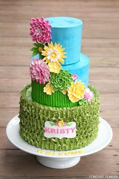 love the bright flowers and ruffly bottom tier | Spring Flowers by Fondant Flinger  |  TheCakeBlog.com