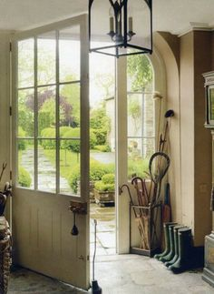Décor de Provence: Simple Country...I like the transition from inside to outside and the umbrella stand/mini mudroom look