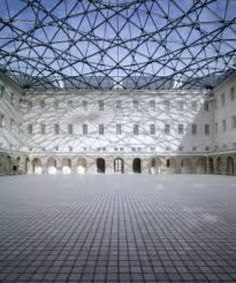 Het Scheepvaartmuseum- National maritime museum. The museum is an island of tiself and the interior has a glass ceiling that is dotted with led lights that light up at night.