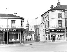 Black and white photograph showing the corner of Water Street and Bridge Street, St. Beecham's clock can be seen in the - Clare Collection 3 - Black and white photographs and drawings of St. St Helens Town, Saint Helens, The Old Days, My Town, Isle Of Wight, Back In The Day, Over The Years, Bridge, Places To Visit