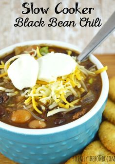 Slow Cooker Black Bean Chili. It's loaded full of vegetables and flavor so you can even get the kiddos to eat it. Click now!