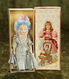 """5 1/2"""" German all-bisque miniature doll, sculpted fancy bonnet, in original box~~One-piece bisque head, torso and legs, pin-jointed arms, sculpted long blonde curly hair in tumbling curls under very fancy ruffled and be-ribboned bonnet, pink neck tie, painted blue boots, antique costume. Generally excellent. The doll is preserved in her original gift box with illustration of young girl pushing her doll in a carriage. Germany, circa 1890,"""