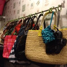I thought of this all by myself. I need my shelf space in the closet & my multitude of purses took up waaaay too much space. I went to Walmart & got a cheap curtain rod. I bought 2 (12) packs of shower curtain rings for $1 each at the dollar store. Hung it on the wall, popped the purses up there, and VOILA!!! Instant storage space!!!!