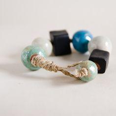 bracelet = hand-made clay beads + organic jute twine
