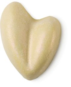 Shimmy Shimmy - Shimmy shimmy into Lush for vanilla scented skin that sparkles. It's shaped like an abstract heart and smells of vanilla and lavender, with a hint of herbal clary sage. The Shimmy Shimmy bar perfumes, softens your skin and makes you shine like a star. The glitter in Shimmy Shimmy is very subtle and gives you a pink-bronze glow that lights up pale, wintery skin.