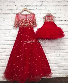 Red mother and daughter duo. Gorgeous red color floor length gown and kids gown with hand embroidery work. Mom Daughter Matching Outfits, Mommy Daughter Dresses, Mom And Baby Dresses, Mother Daughter Fashion, Gowns For Girls, Girls Dresses, Lehenga Gown, Anarkali Dress, African Dresses For Kids