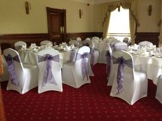 Dusky Lilac organza sashes on white chair covers set for a wedding x