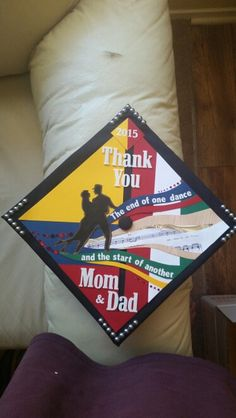 Graduation cap with dance themed decor! Left half with colombian flag colors, right side with Mexican flag comors. Salsa/ballroom dancing theme.