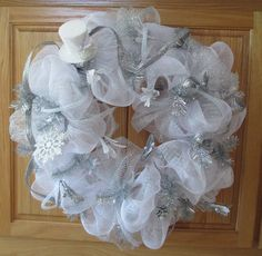 White and Silver Deco Mesh Holiday Wreath w/ a Solid White Hat.