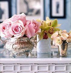 Love flowers in silver teapots