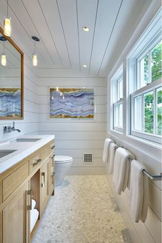 This bubble floor tile is perfect for this coastal bathroom and it works great with the White Oak vanity and shiplap walls