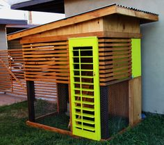 Modern chicken coop. I like the idea of using shutters to open or close on hot or cold days.