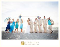 #wedding #photography #weddingphotography #destinationwedding #beachwedding #beach #tweenwatersinnresort #captiva #captivaisland #florida #stepintothelimelight #limelightphotography #bridalparty #bridesmaids #groomsmen #brideandgroom #parasols #blueparasols #blueandtan #kiss