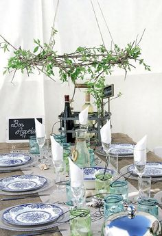 al fresco table setting love the leafy chandelier from twigs and vines so cute, no lights but darling nonetheles. blue and white themed china make precious tablescape