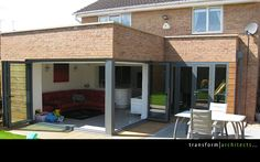 Corner bi-folding doors fully extended back Kitchen Family Extension, L Shaped Kitchen Extension, House Extension Design, Corner Bifold Doors, Bifold Doors Onto Patio, Patio Doors, Garden Room Extensions, House Extensions, Kitchen Extensions