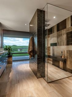 Elegant Bathroom - love the design on the shower wall! And that dark brick shower wall Contemporary Shower, Contemporary Bathroom Designs, Modern Shower, Contemporary Bathtubs, Contemporary Design, Modern Design, Dream Bathrooms, Beautiful Bathrooms, Luxury Bathrooms