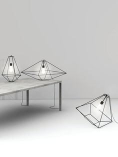 Opinion Ciatti at Fuorisalone lighting lights grey bulbs metal casing geometric shapes grey walls