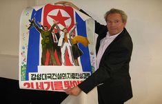 David Heather with a North Korean propaganda poster