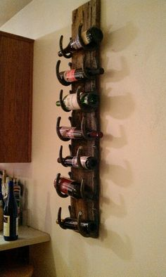 Wine rack old barn wood and horse shoes