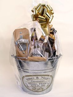 Your beer-loving guests will have tons of fun with this awesome personalized gift basket-in-a-bucket. This entertaining gift is a party in itself, and it could be theirs to take home!  See more here: http://www.capcatchers.com/collections/unique-groomsmen-gifts/products/personalized-gift-basket-with-clear-pouch-capcatcher