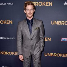 Luke Treadaway in Prada Fall/Winter 2014 collection while attending the 'Unbroken' première in Los Angeles.