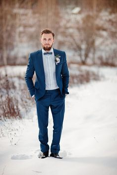 Groom in blue suit + Muted grays and blues For an outdoor winter wedding shoot in the snow   fabmood.com #winterwedding #groomstyle #snow