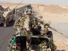 Elements of the ninth during an escort joint with the americans to a column of the us army, personal civil And sof in afghanistan. n.b. the means of the ninth are two v.a.v land rover defender 90 armed with Browning and mg42/ 59.